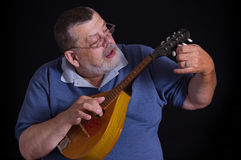 Portrait of a senior tuner with mandolin Stock Image