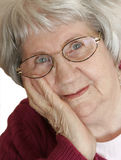 Portrait of a Senior Woman. Portrait of a charming 88 year-old woman in a reflective mood stock images