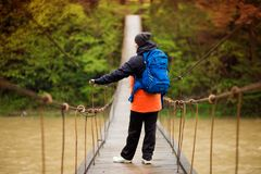 Portrait Of Senior Woman with backpack On Hike cross river royalty free stock images