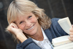 Senior woman reading with books Royalty Free Stock Photo