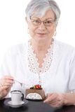 Portrait of senior woman with cake smiling Royalty Free Stock Image