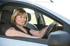 Portrait of senior woman in car Stock Photo