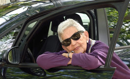 Portrait of senior woman with car Stock Photos