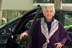 Portrait of senior woman with car Stock Photography