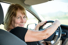 Portrait of senior woman in car Royalty Free Stock Images