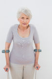 Portrait of a senior woman with crutches Stock Photography
