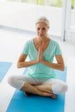 Portrait of senior woman doing yoga Stock Image