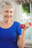 Portrait of senior woman exercising with dumbbells Stock Photography