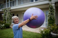 Portrait of senior woman exercising with fitness ball Royalty Free Stock Images
