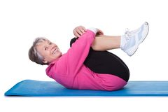 Portrait of senior woman exercising Stock Photo