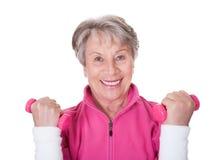 Portrait Of A Senior Woman Exercising Royalty Free Stock Photos