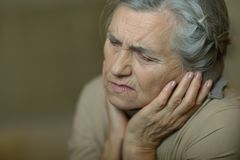 Senior woman feel unwell. Portrait of a senior woman feel unwell royalty free stock photos
