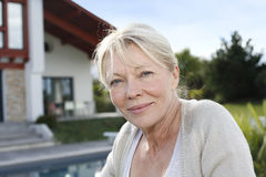 Portrait of senior woman in front of house Royalty Free Stock Photos