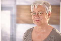 Portrait of senior woman with glasses Stock Image