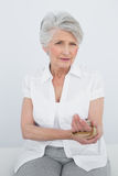 Portrait of a senior woman with hand in wrist brace. Sitting in the medical office Royalty Free Stock Photography