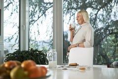 Portrait of senior woman having breakfast stock image