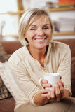 Portrait of senior woman having a cup of coffee Stock Images