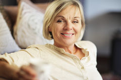 Portrait of senior woman having a cup of coffee Stock Photos