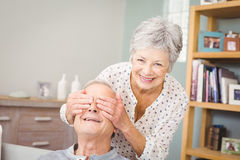 Portrait of senior woman hiding eyes of her husband Royalty Free Stock Photos