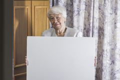 Portrait of senior woman holding banner Royalty Free Stock Images
