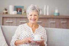 Portrait of senior woman holding coffee cup Royalty Free Stock Images