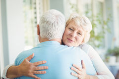Portrait of senior woman hugging her husband Royalty Free Stock Photos