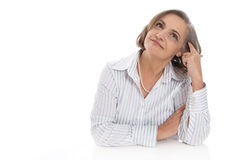 Portrait of senior woman isolated over white dreaming. Royalty Free Stock Photos