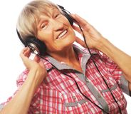 Portrait of senior woman listening to music Royalty Free Stock Image