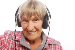 Portrait of senior woman listening to music Royalty Free Stock Photos