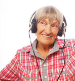 Portrait of senior woman listening to music Stock Images