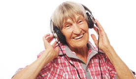 Portrait of senior woman listening to music Royalty Free Stock Images