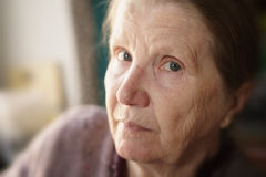 Portrait of senior woman in living room royalty free stock images