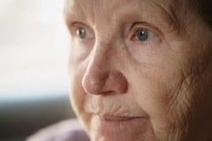 Portrait of senior woman in living room stock photos