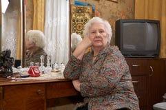 Portrait of senior woman near the mirror Royalty Free Stock Photography