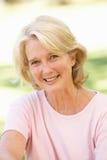 Portrait Of Senior Woman In Park Stock Photos
