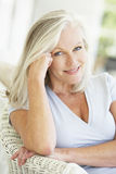 Portrait Of Senior Woman Relaxing In Chair Royalty Free Stock Images