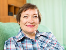 Portrait of senior woman relaxing in couch. At home Royalty Free Stock Images