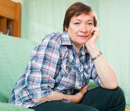 Portrait of senior woman relaxing in couch Stock Photo