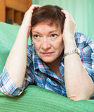 Portrait of senior woman relaxing in couch Stock Photos