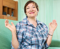 Portrait of senior woman relaxing in couch Royalty Free Stock Image