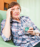 Portrait of senior woman relaxing in couch Royalty Free Stock Photography