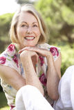 Portrait Of Senior Woman Relaxing In Countryside Royalty Free Stock Images