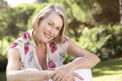 Portrait Of Senior Woman Relaxing In Countryside Stock Photography