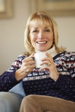 Portrait senior woman relaxing at home Stock Photography