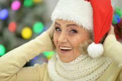 Portrait of a senior woman in Santa hat. Portrait of happy senior woman in Santa hat stock photography
