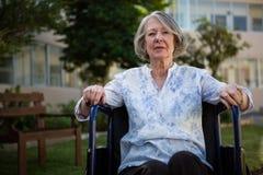 Portrait of senior woman sitting on wheelchair Stock Photos