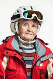 Portrait of senior woman in ski jacket and helmet Royalty Free Stock Images