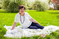 Portrait of senior woman on the spring meadow Royalty Free Stock Images