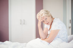 Portrait of senior woman suffering from headache Stock Photography