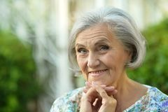 Senior woman in summer park Stock Images